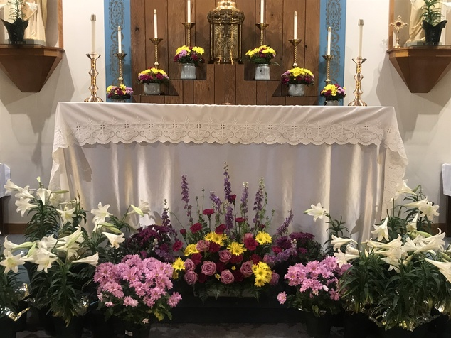 Flowers around a tabernacle