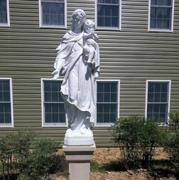 The Statue of Our Lady in front of the rectory.