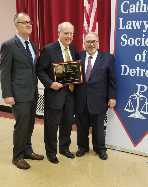 Dennis J. Clark (center) receives the 2019 Msgr. Malloy Award, with his son John (left) and CLSMD Lifetime member John P. Jacobs.