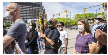 Clergy, Laity lift high the cross as protests continue for sixth day in downtown Detroit