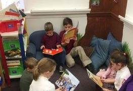 Prayer Partners join the PreK class for story time.
