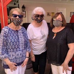 three women in face masks