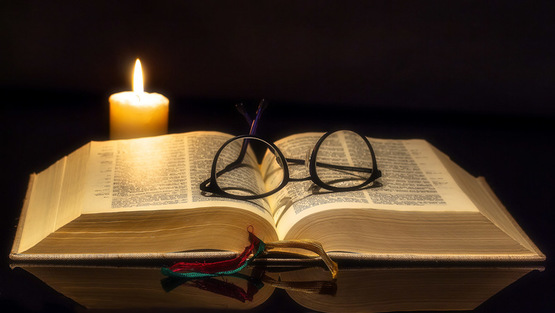 Bible glasses and candle.