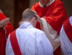 Man being ordained as a Catholic priest by a bishop