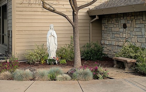 St Anthony Catholic Church San Jose meditation garden featuring statue of Mary.