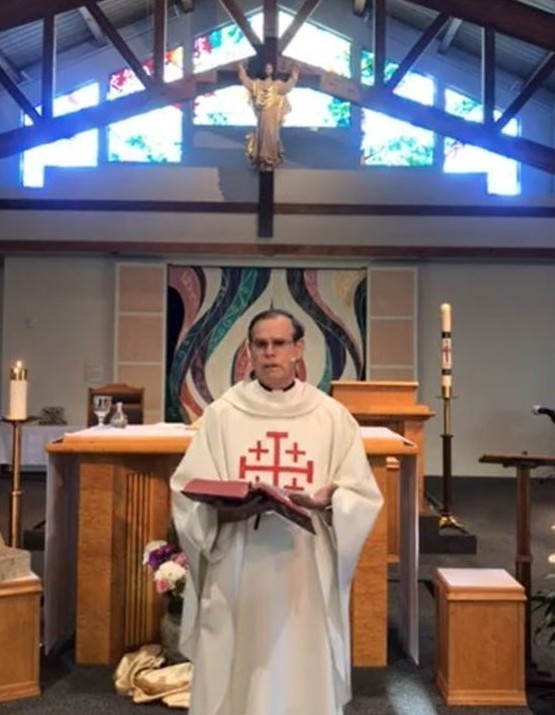 St. Anthony Parish pastor giving homily at McKean Road church