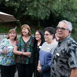St Anthony parish in San Jose progressive dinner smiling group friends.