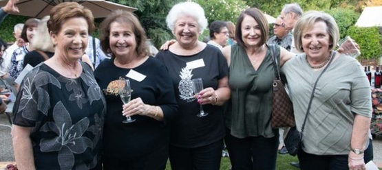 St Anthony parish in San Jose progressive dinner five smiling women.