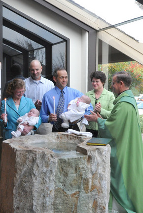St. Anthony Parish twin infant Baptism with priest and adults