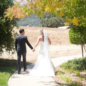 St. Anthony Parish bride and groom walking on path outside the McKean Road church in San Jose