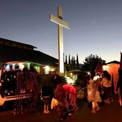 St Anthony parish in San Jose Trunk or Treat lighted cross kids in costume.