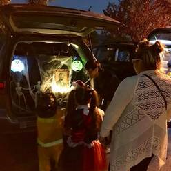 St Anthony parish in San Jose Trunk or Treat kids getting candy at trunk.