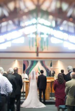 St. Anthony Parish bride and groom being married at altar with people in attendance