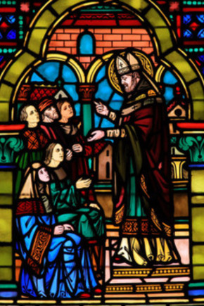 Stained glass window of people at church inititation