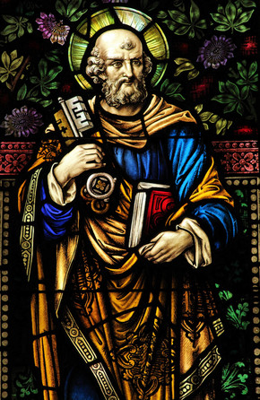 Stained glass window of St. Peter holding a key and a book