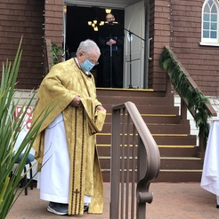 priest putting on gold vestments