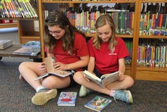 Two Holy Cross students reading in the library