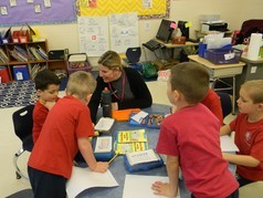 Holy Cross kindergarden students interact with teacher in classroom.