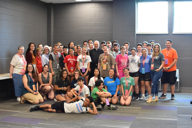 7/24/19: Bishop Da Cunha with the Camp after winning a game of soccer and a pizza party!