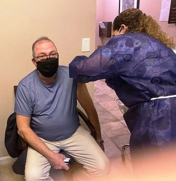 Fr. Ron receives his COVID-19 vaccination