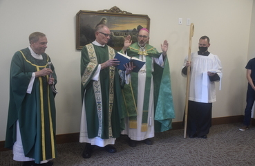 Bishop blesses new faith-formation center in Houghton