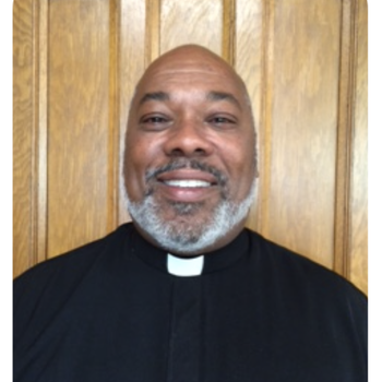 Father Larry Evans presiding at 10am