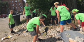 With hammers, nails and weed-whackers, Our Lady of the Lakes students clean city neighborhood