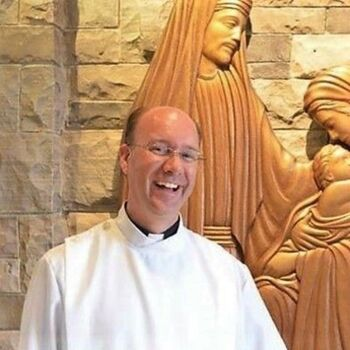 Father john Van Hees of Diocese of Hamilton celebrating his 25th year as a priest