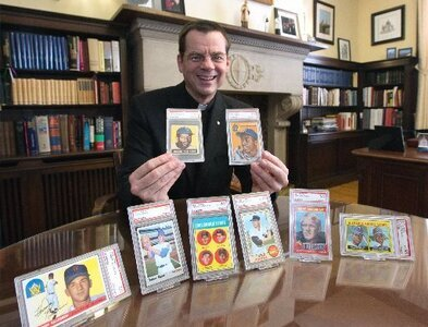 Priest plans to auction coveted baseball cards to aid low-income students