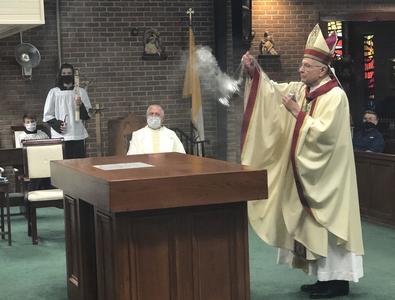 Archbishop Aymond reconsecrates church, altar; calls priest's acts 'demonic'
