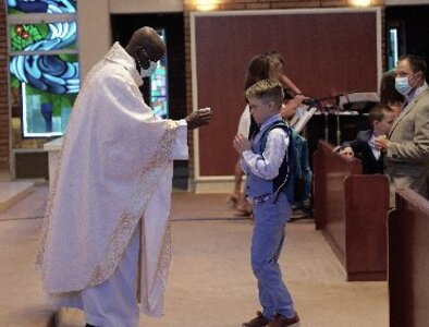 First Communion recipient overcomes obstacle, gives hope to others