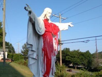 Basilica quickly restores Christ statue after it's covered with red paint
