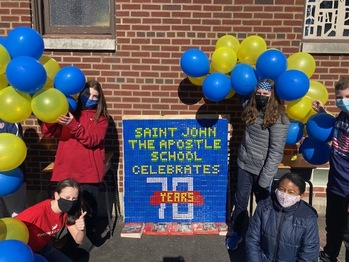 St. John students commemorate school's 70th anniversary with a Rubik's Cube project