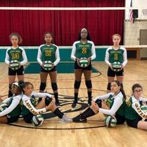 St. John the Baptist School's seventh grade girl's volleyball team picture in the school gym.