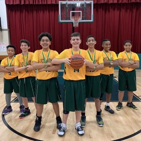 St. John the Baptist School's seventh grade boy's basketball team picture in the school gym.