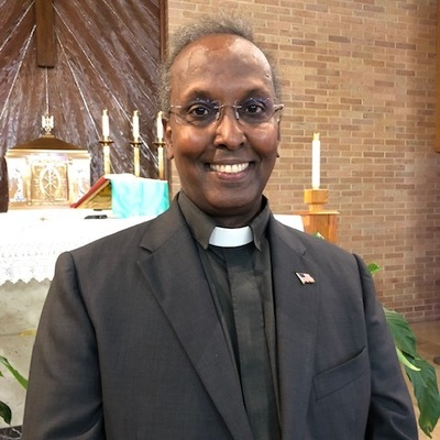 Father Isak Keyman-Ige