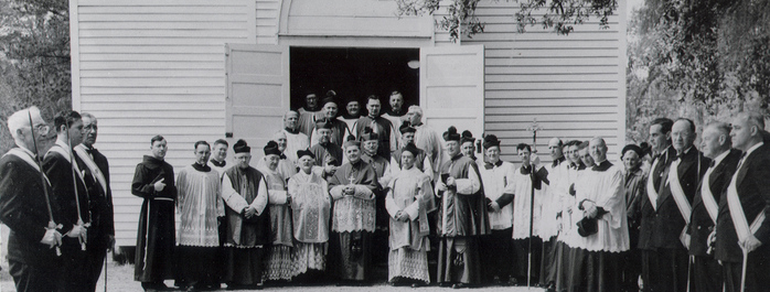 Clergy and Knights of Columbus outside St. George Church, ca. 1935