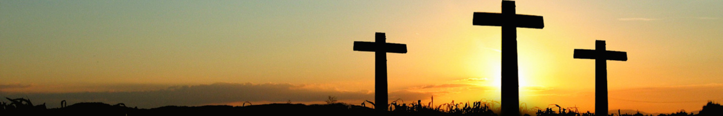Image of sunset with three crosses in scene