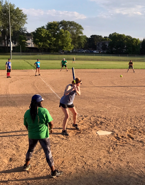 Picture of Catholic Softball Group in the fields at Little Canada.