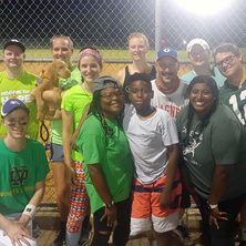 Picture of Catholic Softball Group team under the lights.