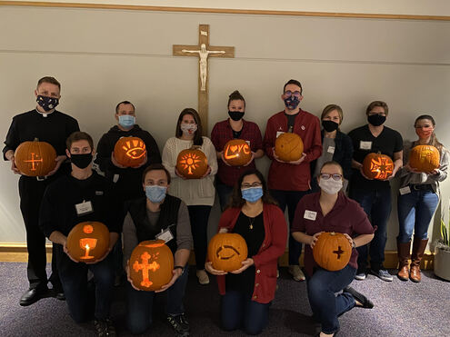 St. John the Baptist Young Adults carve pumpkins.