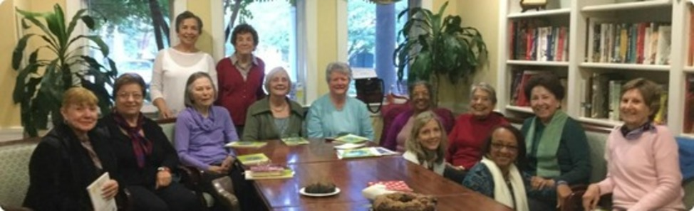 Tuesday's Bible Group participants celebrate the 93rd birthday of member Bel Ceja (fourth from right) in the library of Bartholomew House Assisted Living.