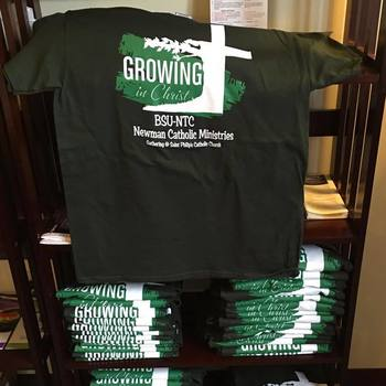 Newman T-shirts and Lanyards are here!