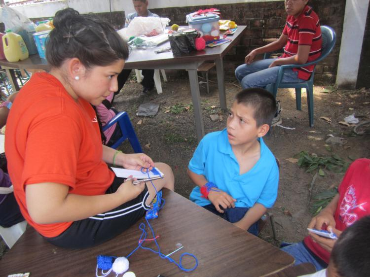 Jose Martin  Hernandez from St. Ambrose 2012 mission trip makes friends with Los Angelitos