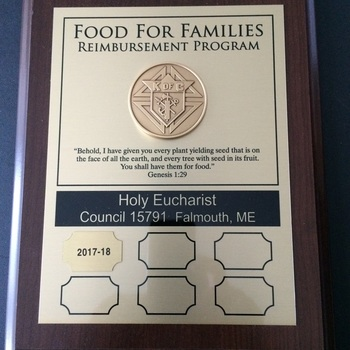 Knights receive award for their Spring Food for Families Drive.