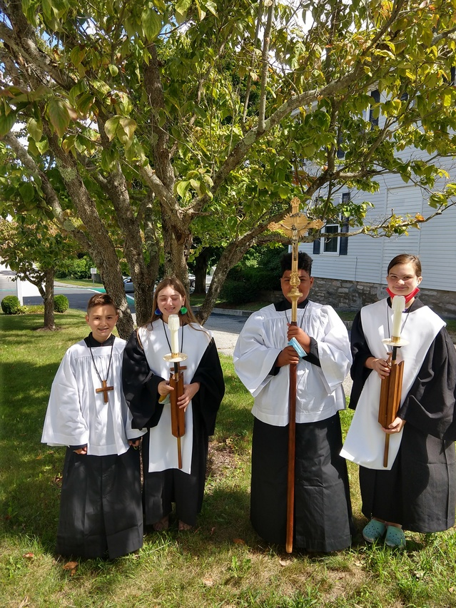St James Alter servers model their new vestments
