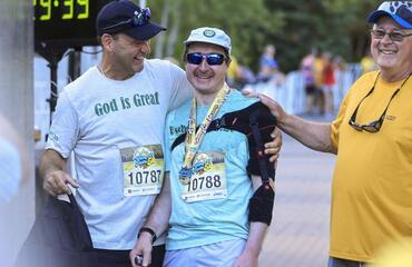 Recovering from his second stroke, Fr. Ben Hadrich walks William A. Irvin 5K