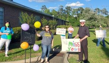St. Columba parishioners fill parking lot for 'Parade of Love' benefit