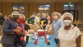 Volunteers help pack 40,176 meals to help feed hungry in Haiti