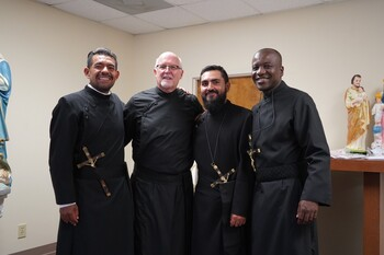 Three brothers profess final vows